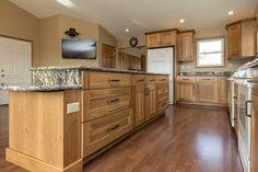 Designers | Sarah, Bill (Flooring) Cabinets: Dura Supreme Cabinetry Napa Panel Door in Hickory Sage  Granite: Golden Thunder  Flooring: Quick Step Laminate Dark Hickory