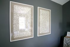 framed linen..or great grandmom's unfinished quilt squares