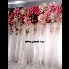 A perfect paper flower backdrop for a bridal bower, baby shower, first birthday or princess theme. Shades of pink and gold. Follow us on Instagram or Facebook @simplylavishevent