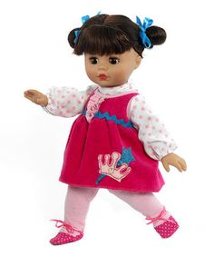 Little ones need a companion who's there for every tea party, playtime romp and adventure. This darling doll is articulated at the neck, shoulders and hips and has brown eyes that open and close, matching chocolate locks and a sweet outfit to boot.