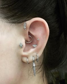 Oops I did it again! A little daith by @pennypiercer at the @maria_tash x @aubadejewelry pop-up in Dubai. Just a plain white gold clicker this time but I'll swap it for a pearl eternity once healed. A pair of single spike rings are on the way to complete my triple lobe suite. Conch, tragus, forward helix and 3rd lobe piercings by @wklp , 2nd lobes and flat by @bentauber || Granulated Triple Spike Ring