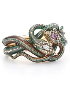 Enjoy some antique jewelry: an estate century enamel diamond, ruby and emerald-coiled snake bracelet by Fred Leighton at Bergdorf Goodman. Emerald Bracelet, Snake Bracelet, Snake Jewelry, Animal Jewelry, Boho Jewelry, Jewelry Box, Jewelry Bracelets, Jewelry Accessories, Fine Jewelry