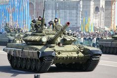 Kazakh Army T-72B tanks rolling down Astana's Independence Square in the 2011 Kazakhstan Constitution Day Parade.