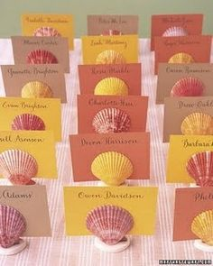 Place cards for a tropical wedding, paint sea shells and use card stock in your wedding's personal color scheme...