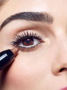 Apply Maybelline Color Tattoo Concentrated Crayon in 'Creamy Chocolate' to fill in below the lower lash line, starting at the outer corner, working about half way in. This allows for a pop of color around your eyes for a natural summer makeup look. You can find this shade and 9 other colors here.