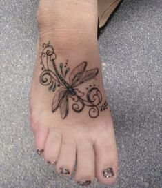 Dragonflies tattoo. I would like it a bit brighter colors