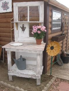 "DIY Craft Projects for the Yard and Garden - Trash to Treasure ""The potting benches are made from old doors. I saw this idea in a Country Sampler magazine a few years back. The sunflower next to one of the benches is made from an old hog feeder pan, an old metal fence stake and old garden hose."""