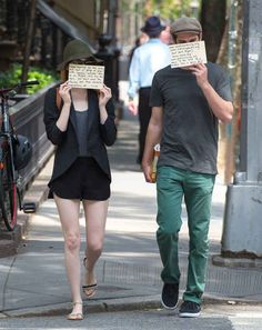 Emma Stone & Andrew Garfield Use Signs to Raise Awareness for Charities Again!: Photo Emma Stone and Andrew Garfield share a message with photographers after eating breakfast at Cafe Cluny on Tuesday morning (June in New York City. Emma Stone Andrew Garfield, Hollywood, Celebrity Couples, Girl Crushes, Cute Couples, Role Models, My Idol, Fashion News, Cool Outfits