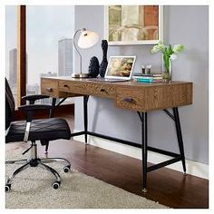 Designed to present a contemporary take on excess inventory, the Surplus desk is a rustic piece that reclaims and repurposes the sentiments of old. Made with a wood grain-patterned melamine top and powder-coated black steel legs, the beauty of Surplus is in its ability to redefine industrial era design for the modern day. Surplus is outfitted with easy glide right and left storage drawers, and one long center drawer for pads and pens or keyboard storage. All four foot glides are adjustable…