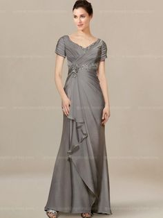 Fashion forward mother of the bride dress with beaded details looks elegant. Fitted ruched bodice features short sleeves and ultra-feminine V neckline. A flattering waist gathers in front, which falls softly to the cascade skirt. Back is zipper closure, fully lined. Available in 60 colors, shown in Charcoal.