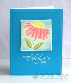 handmade Mother's Day card ... like the classic lines ... two emboss lines around the outer edge ... blue card face ... white embossed greeting ... lovely colored flower in a square as focal point ...