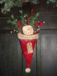 Use a santa hat to make a great holiday door decoration!  Get your holiday decor at Old Time Pottery!
