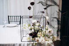 Stylish wedding centerpieces / geometric decor / black and white flowers