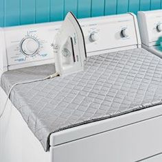QUILTED IRONING MAT.  Attaches to the top of the dryer with magnets. Great for small apartment dwellers. The Insul-Batting needed for the project can be purchased at fabric stores. If you have any scraps left, make some pot holders as well!