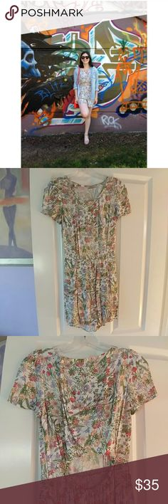 Jack Wills floral romper Floral romper with back cutout by Jack Wills. The back buttons are a little bit loose, but still fully functional. In great condition. Perfect for summer! Jack Wills Dresses