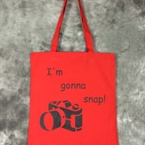 Hand painted red bag with I'm Gonna Snap! design on it. Design is painted in black on one side only. Perfect for Photographers, conventions, trips to the comic shop, as a reusable shopping bag or as a purse.  Red 100% cotton canvas promo bag (thinner than reg. canvas bags from the craft store),...