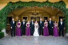 Colorful bridal party in traditional suits and purple bridesmaid dresses | villasiena.cc