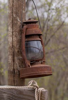 Rusty old lantern hung for its last time Country Farm, Country Life, Country Living, Country Decor, Old Lanterns, Antique Lanterns, Rust In Peace, Over The Garden Wall, Lantern Lamp