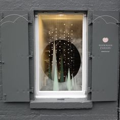 shop lights off/window light on