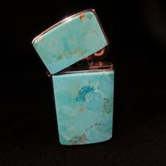 "This Zippo lighter is graced with turquoise on one side, on the lid and body. This reusable lighter uses lighter fluid (not included) and features a brushed silver back. It measures 2 1/4"" long, 1 1/4"" wide and is 1/2"" thick (including the 1/8"" thick turquoise). Made in USA."