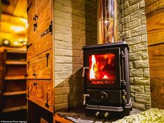 Former surveyor Guy Williams spends converting a wrecked horse box into a plush 'log cabin van' Small Wood Burning Stove, Horse Box Conversion, Motorhome Conversions, Travel Around Europe, Horse Trailers, Douglas Fir, House On Wheels, Van Life, Tiny House
