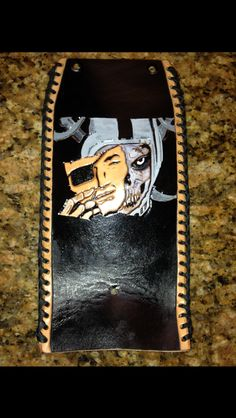 Raiders design for Harley gas tank. Hand tooled and painted.  Laced with black kangaroo lace.