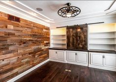 We love the way this den turned out.  The #stikwood on the accent wall complements the custom #barndoor on the built ins.  The ceiling fan that the customer selected from @cardelloltg adds a cool touch to the room also. #builder #new #newhome #construction #design #interiordesign #rustic #beautiful #den #builtins #custom @stikwooddesign