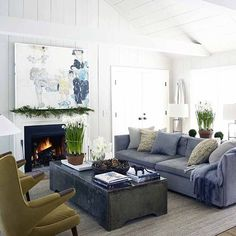 The Coziest Rooms On Instagram #refinery29  http://www.refinery29.com/cozy-winter-room-decor-instagram-pictures#slide-11  An otherwise summery white-and-blue room feels more seasonal thanks to pops of green and a roaring fire....