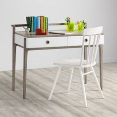 Small desk that can be tucked in anywhere, creating an instant home office.  Attractive enough for living room, bedroom, front hall.  From Land of Nod.  Wrightwood Desk (43.5 x 23.75 x 34.5 h).