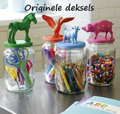 glue plastic animals to the top of mason jar lids and spray paint...cute for kids craft organization
