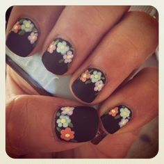 Black nails with pops of bright color with flowers.