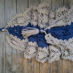 Knitted blanket scarf with tassels. Crocheted blue beige shawl.