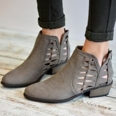 The perfect bootie for Spring, Summer and Fall! A unique, comfortable design with cut-out side slits featuring a stylish cut-out pattern. Stacked block heels create subtle lift to complete the design. Color options: black grey tan taupe Details: These booties rise to an ankle height These booties feature faux suede material Toe shape: Almond Heel height/type: 1.8-Inch block Platform height: 0.31-inch platform Shaft height: 4.1-inches Circumference: 10 inches Width: Medium Lining: No lini...