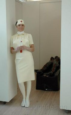 Nurse in her shiny rubber uniform waiting to perform her duties
