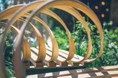 Award winning furniture and lighting company, Tom Raffield, unveils brand new 'Green Range' collection and creates impressive main-avenue Pavilion with spiralling steam bent bench in collaboration with RHS twice gold medallist Darren Hawkes. Chelsea Flower Show 2018, Tom Raffield, Lighting Companies, New Green, Garden Bridge, Playground, Bamboo, Bench, Outdoor Structures