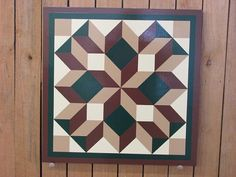 This barn quilt is the broken diamond pattern in medium brown, medium green, chamois and tan with a brown and green border. The barn quilt is Barn Quilt Designs, Barn Quilt Patterns, Mosaic Patterns, Pattern Blocks, Quilting Designs, American Flag Decor, Painted Barn Quilts, Barn Art, Small Wood Projects