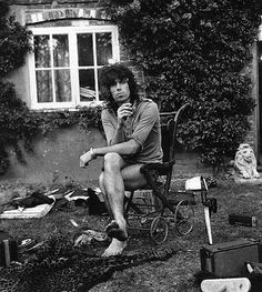 keith richards in his front yard | rolling stones | chilling | smoking | pram | rock star | life style | guitarist / Heroin