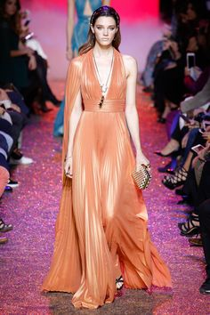 Elie Saab Spring 2017 RTW: What a goddess! I adore the peach color. The pleating is fantastic! Pleating is a trend. I like the one shoulder draping detail.
