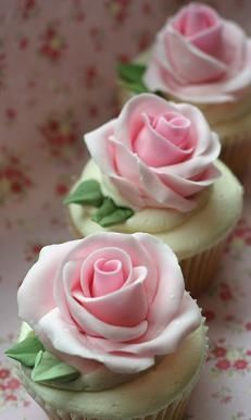 pretty pink rose cupcakes; I would change the colors. We could do this for the Ladies' Tea. :)