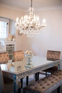 glam mirrored table velvet tufted chairs.