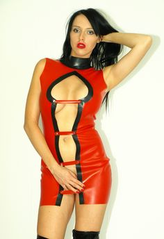 Red latex rubber outfit. Buttoned by straps at the front, zipper in the back http://www.obuwie-erotyczne.pl/item.html/id/4094940587