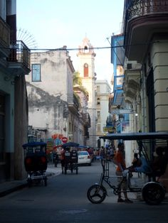 One of my favorite places in #Havana #Cuba to watch the world go by. This is the street off the Cathedral Square where Hemingway's Bodgeuita del Medio still stands. If you fancy going to his other haunts, take one of these bici-taxis. They are super fun! Want more #traveltips & #adventure stories from #Cuba? Check out my book #CubicletoCuba. #books #travel #traveling #oldhavana #cubatravel #inspiration