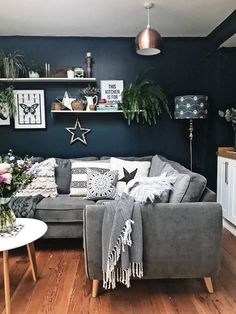 Another view of the sofa. How gorgeous is that blue? Hague Blue by Farrow and Ball with a grey sofa, monochrome prints and soft furnishings and plenty of plants #farrowandball #hagueblue #kitchen #livingroom #hygge #rustic #rusticliving #melaniejadedesign #homedecor #decor #monochrome #interiors #interiordesign