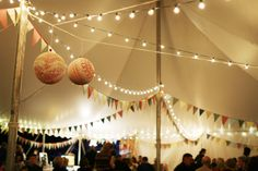Balloon doily paper mache bunting tent Circus theme big top wedding. Shot in Minneapolis by Gigi Hickman. www.gigihickman.com