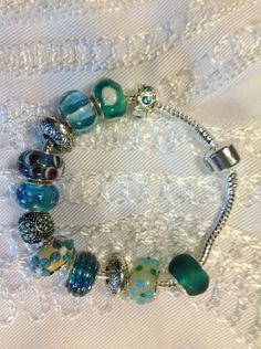 12 piece Pandora style with greens and blues by Beadnbooty on Etsy