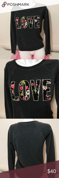 Victoria's Secret pullover sweater LOVE XS Victoria's Secret pullover sweater in size XS. LOVE across front in floral print. 60% cotton 40% polyester. Soft and comfy sweater! No trades. Brand new with tags Victoria's Secret Tops Sweatshirts & Hoodies