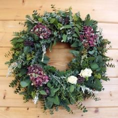 Arriving fresh with the scent of a Northwestern forest, this Victorian Wreath will dry slowly into a long-lasting keepsake. A bed of fresh spiral eucalyptus, seeded eucalyptus and fir cradle puffs of artemesia, hydrangea, purple oregano, and dried white roses. Aromatic fir and eucalyptus base. Elegant door, wall, or mantel decoration. Handcrafted medley of fresh greenery accented with flowers and herbs. Made for use indoors or in a sheltered outdoor area. Handmade in California