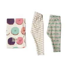 """We are so excited to now be offering newborn packages--for all of you expectant mothers, and baby shower goers. This package includes an Organic Donut Swaddle Blanket (size 35""""x35""""), one pair of Organic Mint Scallop Leggings in size 0-3 months, and one pair of Organic Black and White XOXO leggings in size 3-6 months. These packages are perfect for babies from the second they are born, and continue to grow along with them. The leggings in this pack are discounted to 40%..."""