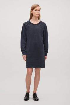 COS image 1 of Sweatshirt dress with seams in Black
