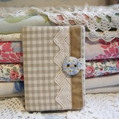Beige gingham needle case.